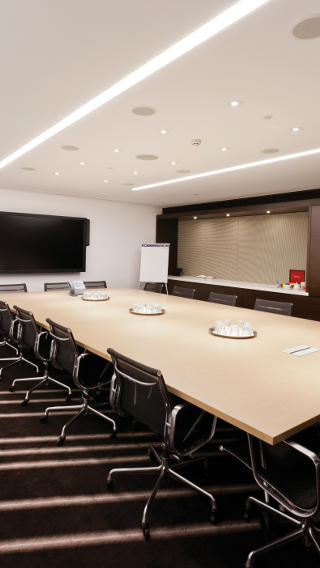 This meeting room at Westfield Sydney uses Philips office lighting controls to help save energy