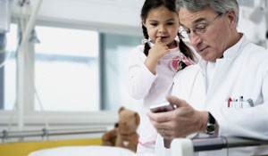A doctor and a child under Philips lighting that helps a hospital's staff to be happier and more productive